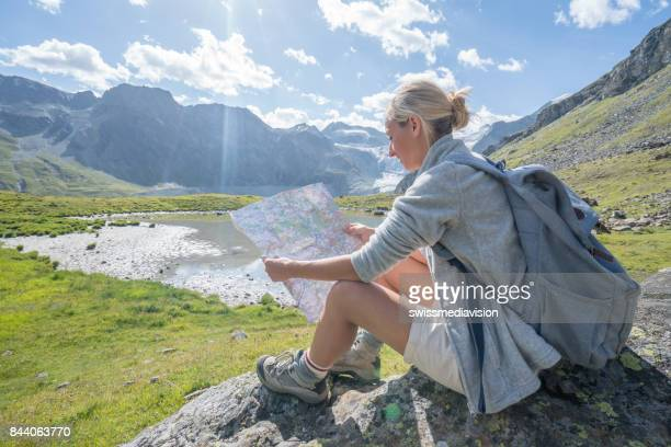 Hiker female looking at trail map