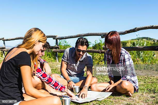 Hiker friends planning a route on a map