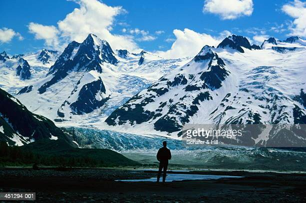 Hiker gazing at mountains, Glacier Bay National Park, Alaska, USA