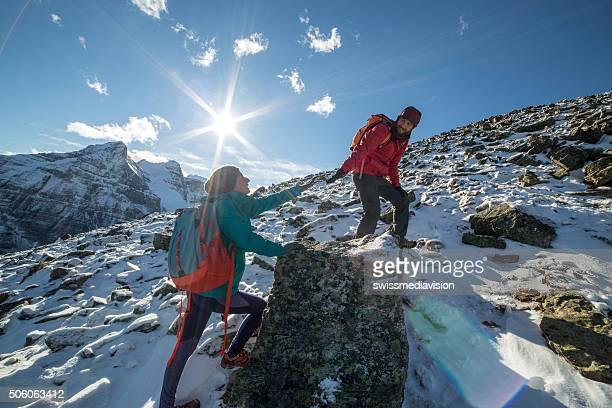 Hiker helping partner