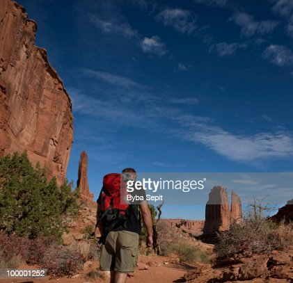 Hiker in a redrock country : Stock Photo