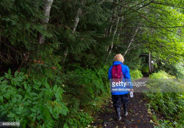 Hiker in Alaska rainforest