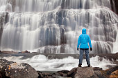 Hiker in front of the Dynjandi waterfall, Fjallfoss, West Fjords, Iceland, Europe