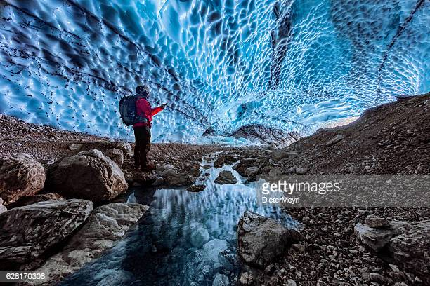 Hiker in ice cave,  Bavarian Alps - Berchtesgaden National Park