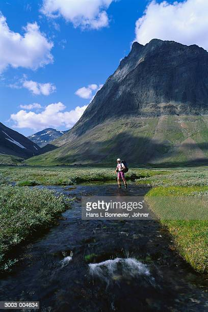 Hiker in Mountain Stream