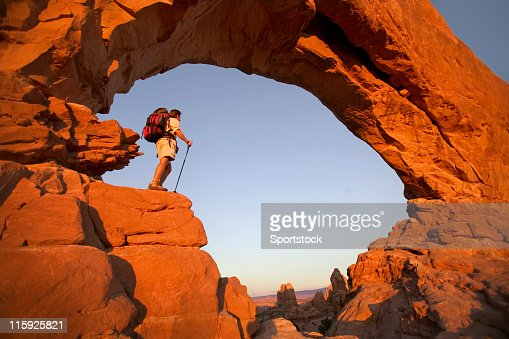 Hiker in Rock Arch Looking at View