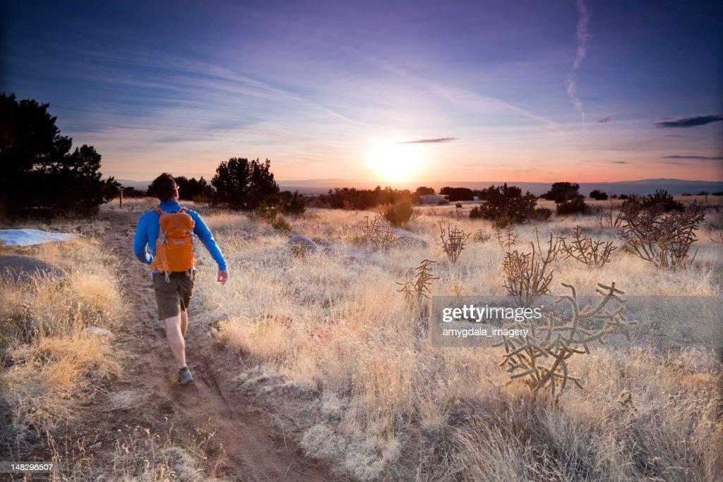 hiker landscape sunset