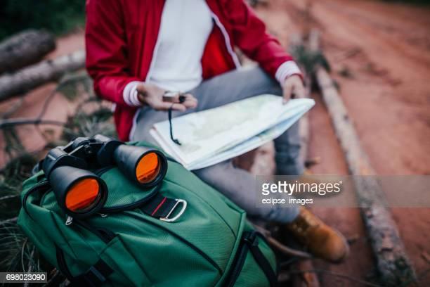 Hiker Looking at maps
