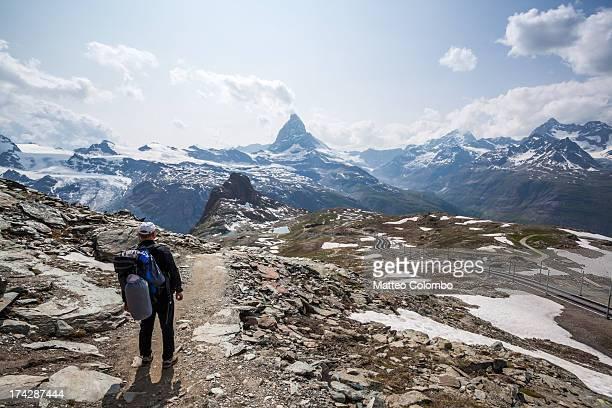 Hiker looking at Matterhorn in summer, Switzerland