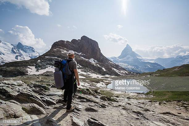 Hiker looking at Matterhorn mountain in summer