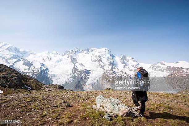 Hiker looking at Monte Rosa glacier in Switzerland