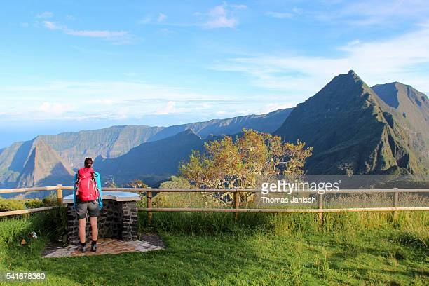 Hiker looking into Cirque de Mafate from Col de Boeuf, Reunion island