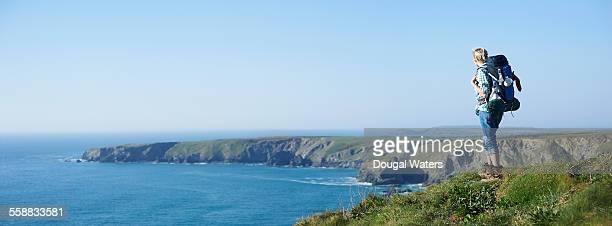 Hiker looking out along Atlantic coastline