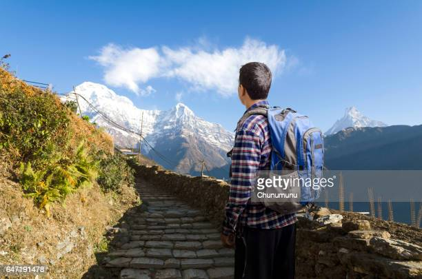 Hiker looking to way leading to mountains