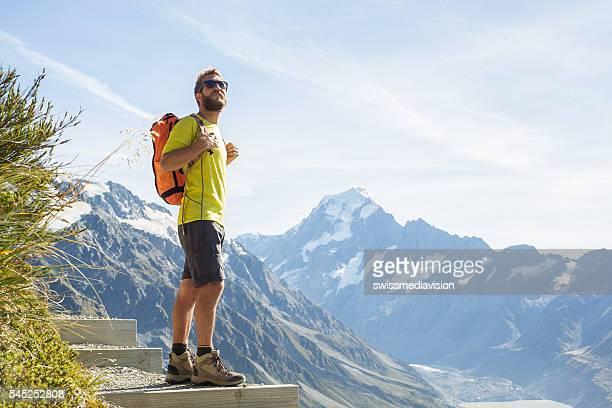 Hiker looks at mountain peak