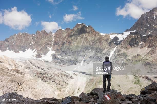 Hiker looks at mountain range