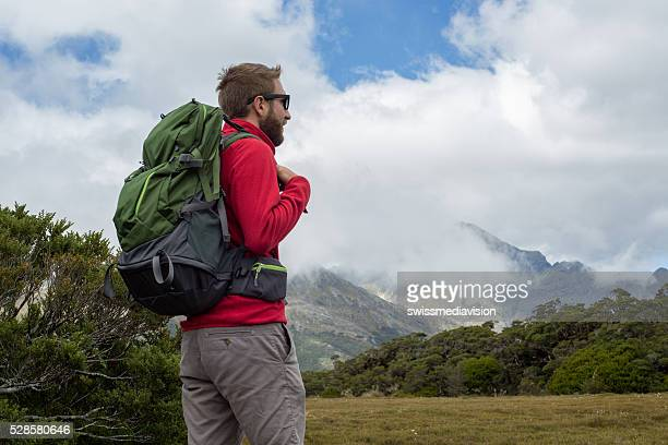 Hiker looks at view, New Zealand