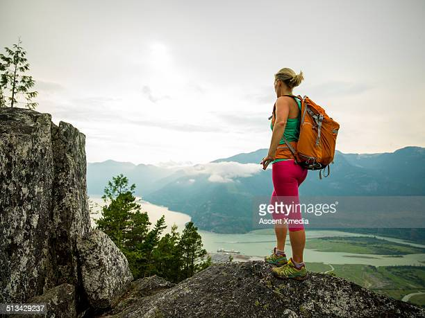 Hiker looks off from mountain ridge crest