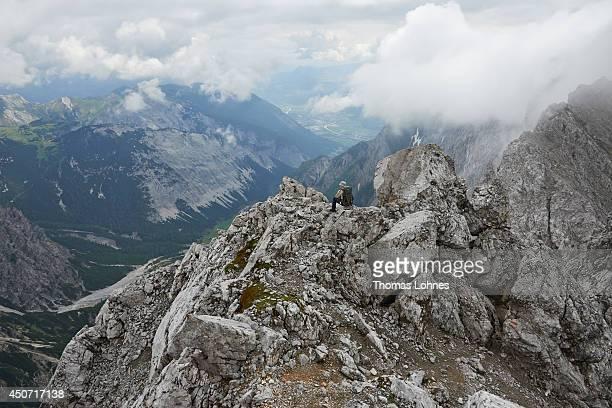 A hiker makes a break on his way to the mountain 'Hochnissl' at the Karwendel region on June 13 2014 near Vomp Austria