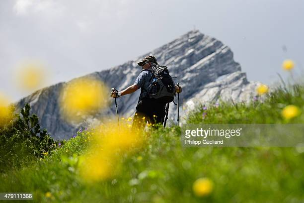 A hiker makes his way towards the Alpspitze in the Bavarian Alps on June 26 2015 near GarmischPartenkirchen Germany The Bavarian Alps are a popular...