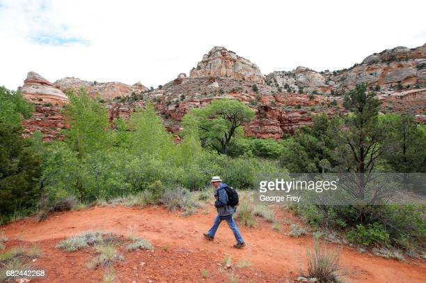 A hiker makes his way up a trail to Calf Creek in the Grand StaircaseEscalante National Monument on May 10 2017 outside Boulder Utah The newly...