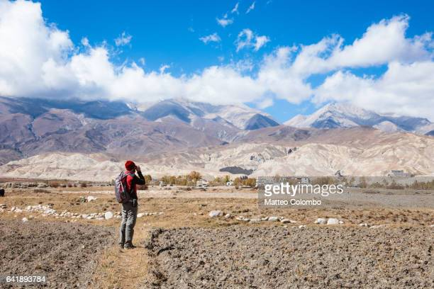 Hiker near Lo Manthang, Upper Mustang region, Nepal
