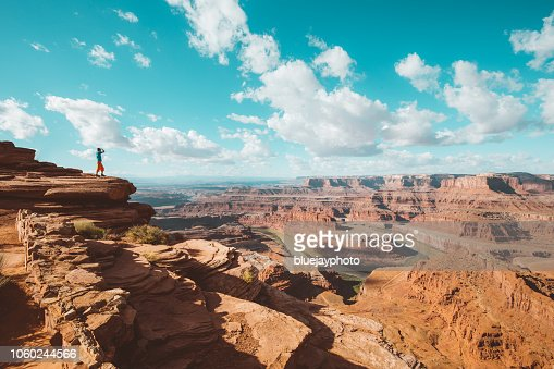 Hiker on a cliff in Dead Horse Point State Park, Utah, USA : Stock Photo