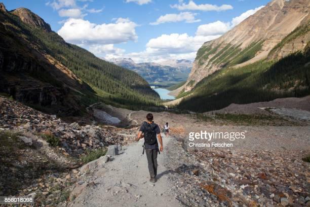Hiker on a trail toward Lake Louise, Banff National Park, Canada