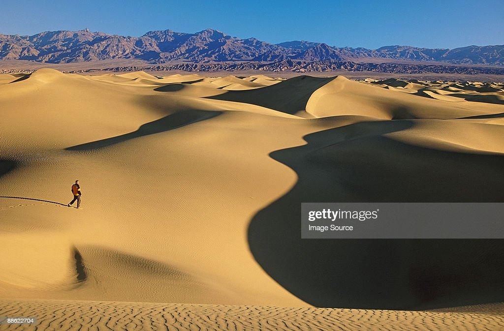 Hiker on mesquite sand dunes