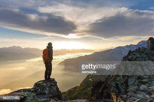 Hiker on mountains enjoy sunrise