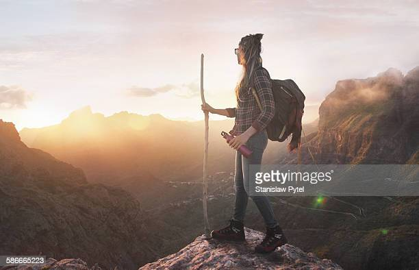 Hiker on moutain summit, sunset