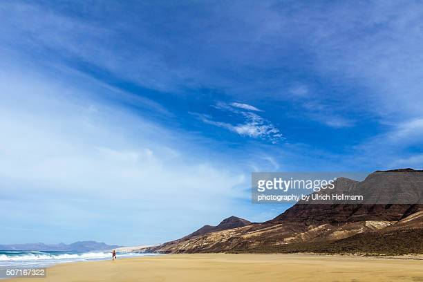 Hiker on Playa de Barlovento, Fuerteventura, Spain