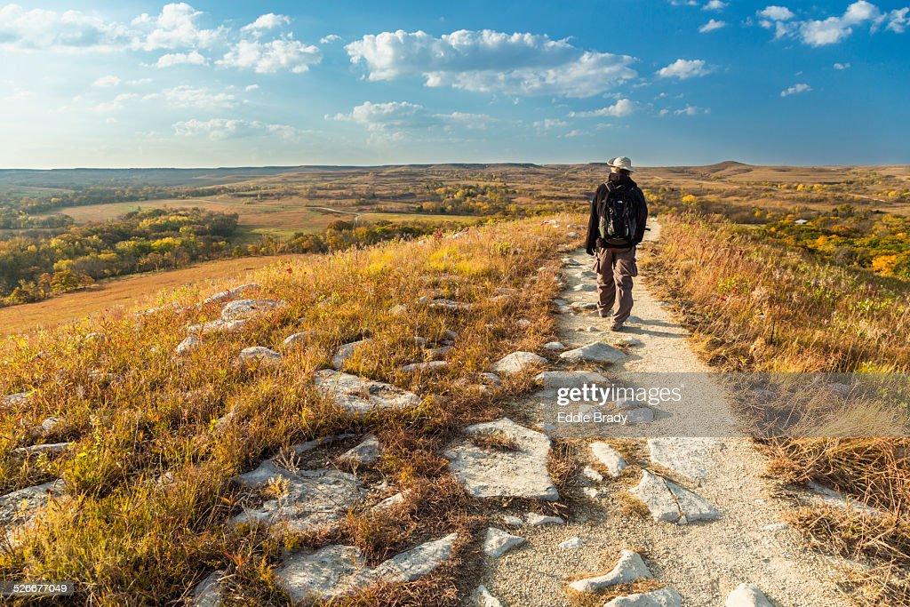 A hiker on the Konza Prairie Nature Trail