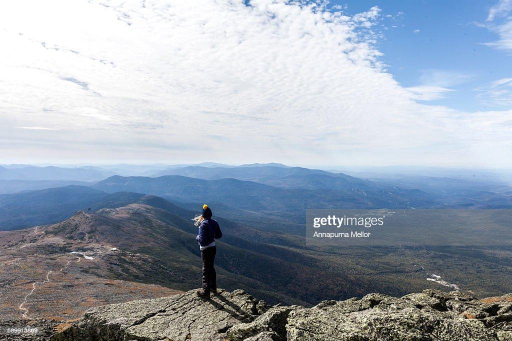 A hiker on the summit of Mount Washington