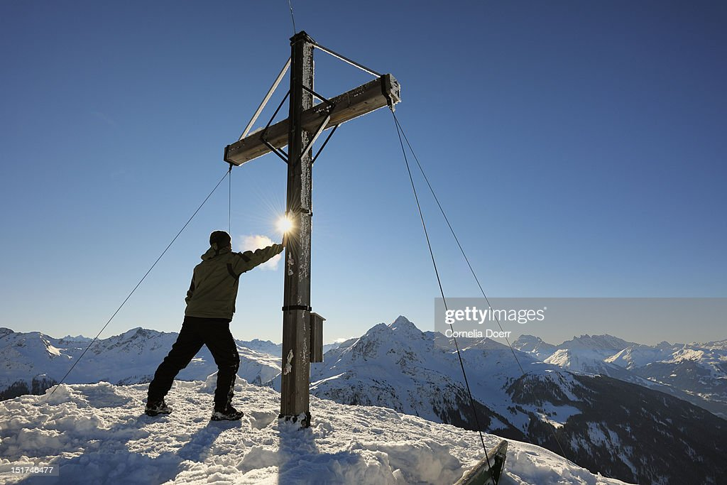 Hiker on the summit of Muttjoechle : Stock Photo