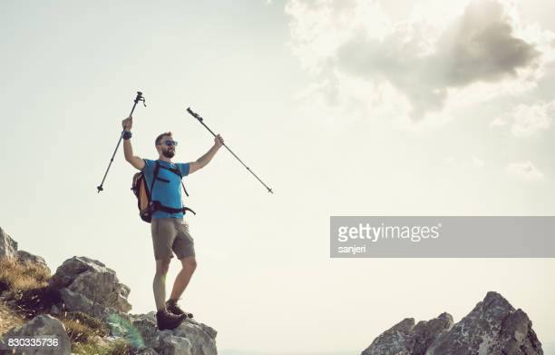 Hiker Raising Arms on Top of Mountain