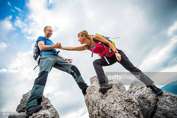 Hiker Reaching For A Helping Hand