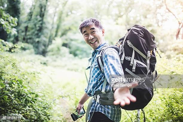Hiker reaching hand toward camera