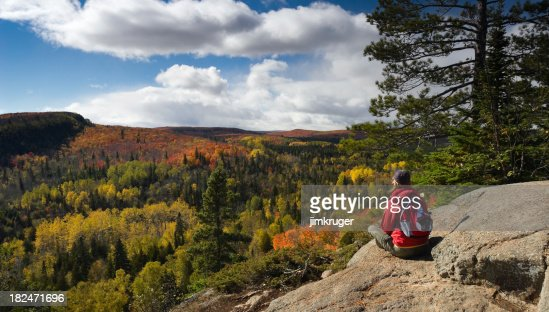 Hiker resting and taking in an Autumn view.
