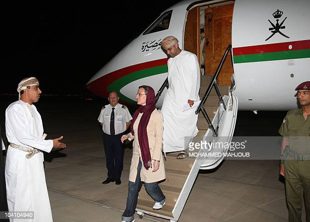 US hiker Sarah Shourd who was released by Iran after more than 13 months in detention is greeted by Omani officials upon her arrival at the Omani...