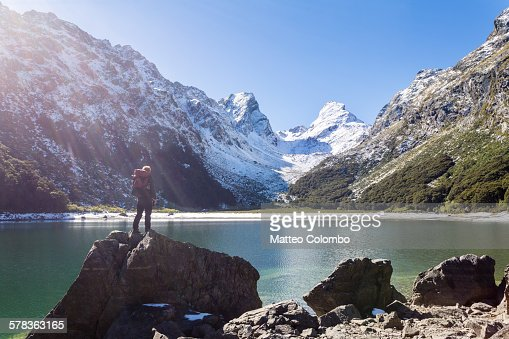 Hiker standind at lake Mackenzie, Routeburn track