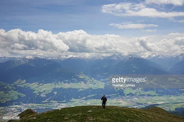 A hiker stands at the mountain 'Niedernissl' at the Karwendel region on June 13 2014 near Vomp Austria The Karwendel is the largest range of the...
