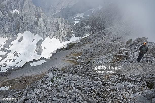 A hiker stands on the 'Lampsenspitze' at the Karwendel region on June 13 2014 near Vomp Austria The Karwendel is the largest range of the Northern...