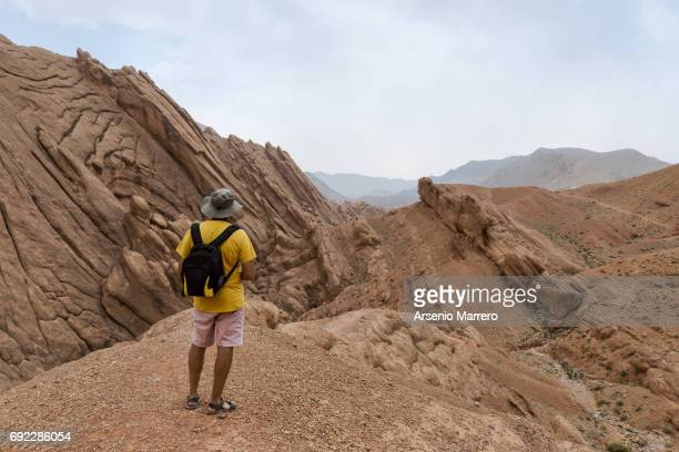 Hiker staying on top Dades Valley in south Morocco