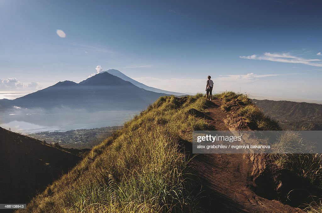 Hiker staying on top of  Mount Batur : Stock Photo