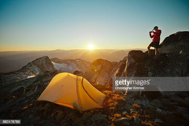 A hiker takes a picture of his tent while camping on Saxifrage Peak.