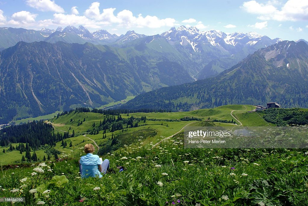 hiker takes a rest at Fellhorn, Allgäu Alps : Stock Photo
