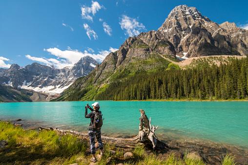 Hiker takes smart phone pic across mountain lake
