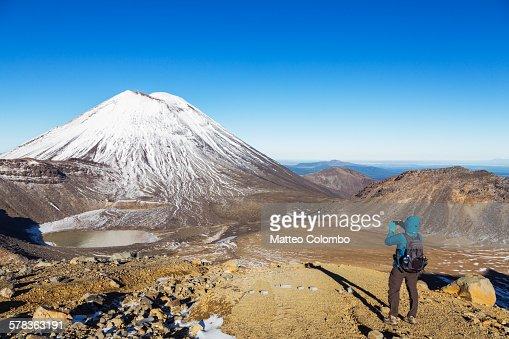 Hiker taking a photo of Mt. Ngauruhoe, New Zealand