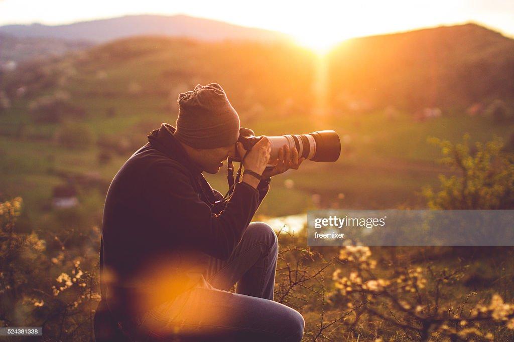 Hiker taking photos : Stock Photo